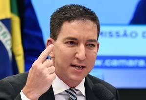 Glenn Greenwald participa de audiência na Comissão de Constituição e Justiça (CCJ) da Câmara Foto: EVARISTO SA / AFP