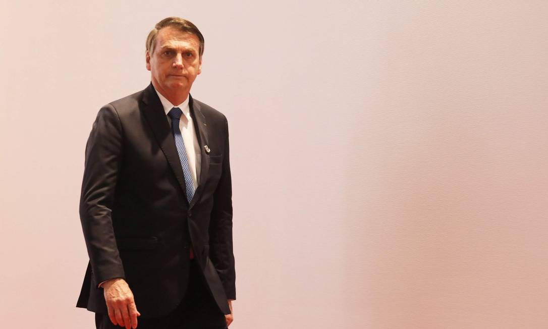 Presidente Bolsonaro chega para a foto de família em encontro do G-20 em Osaka Foto: LUDOVIC MARIN / AFP