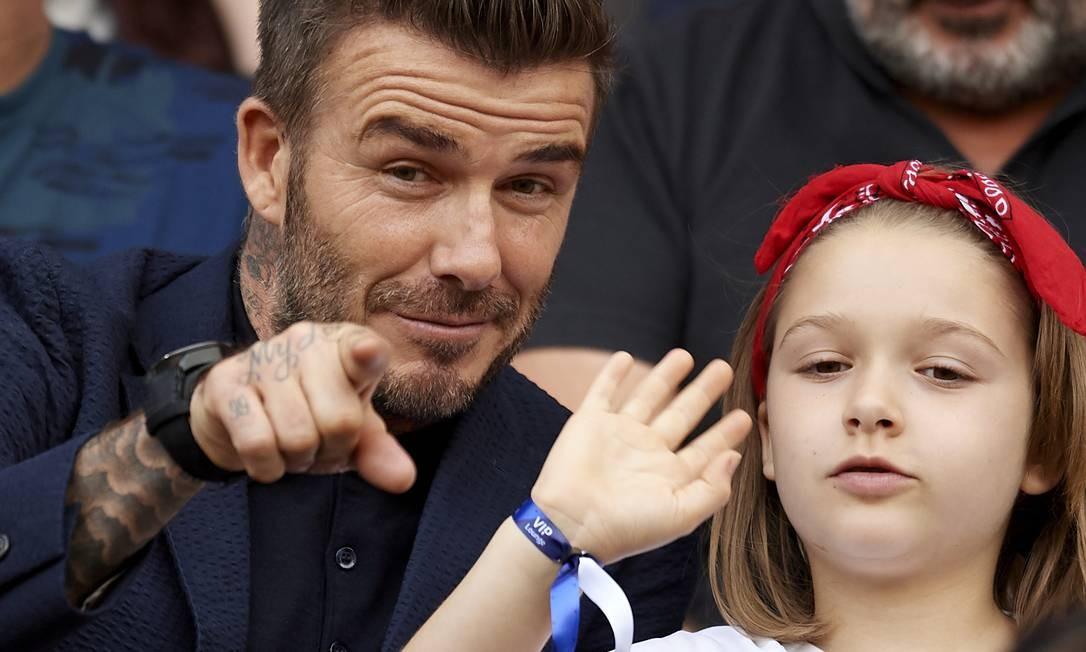 David Beckham e Harper, a filha de 7 anos do ex-jorgador de futebol, roubaram a cena durante a partida entre Inglaterra e Noruega, na Copa do Mundo Feminina, nessa quinat-feira. Confira os cliques Foto: NurPhoto / NurPhoto via Getty Images