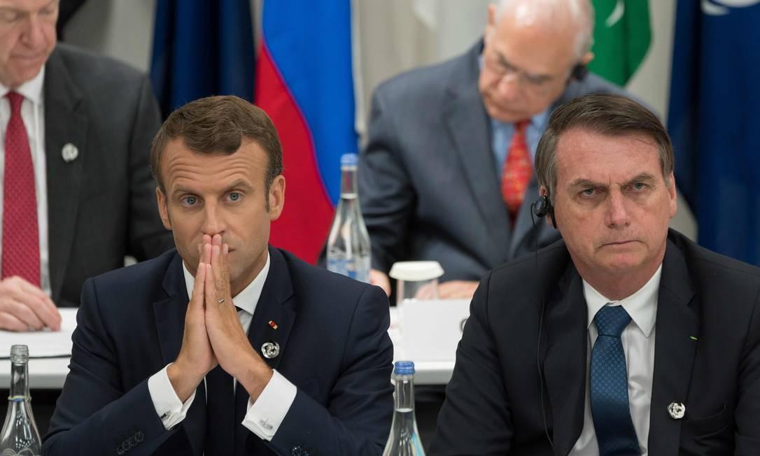 Emmanuel Macron e Jair Bolsonaro, durante uma das reuniões da cúpula do G-20 Foto: JACQUES WITT / AFP
