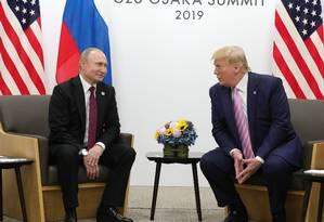 Trump e Putin, durante reunião do G-20 Foto: MIKHAIL KLIMENTYEV / AFP