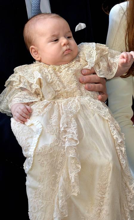 Na imagem, a apresentação do príncipe George, filho do príncipe William e de Kate Middleton, em outubro de 2013 Foto: WPA Pool / Getty Images