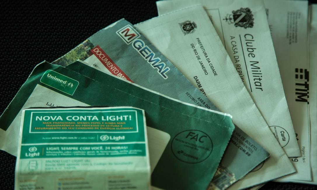 Cadastro positivo beneficia quem paga suas contas em dia Foto: Brenno Carvalho / Agência O Globo