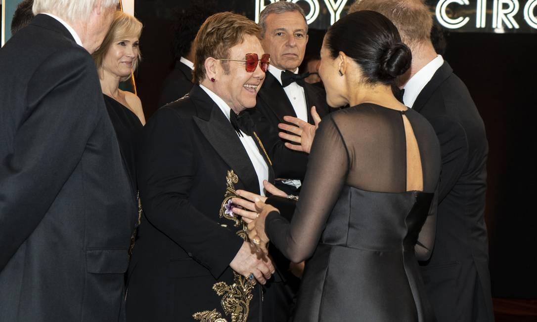 O casal real também encontro Elton John, amigo pessoal de princesa Diana, que está na trilha sonora Foto: WPA Pool / Getty Images