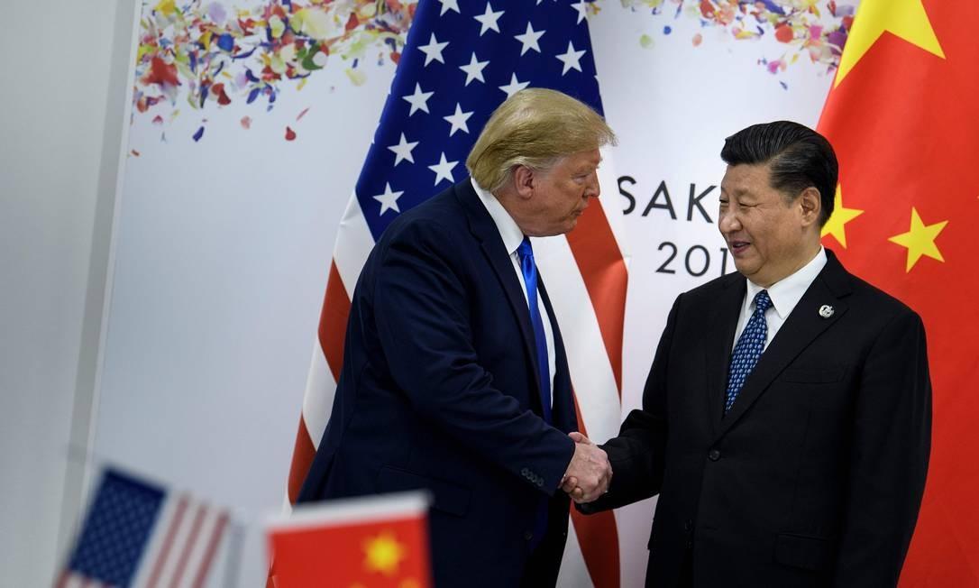 Trump e Xi no G20: encontro ajudou relação com Huawei. Foto: BRENDAN SMIALOWSKI / AFP