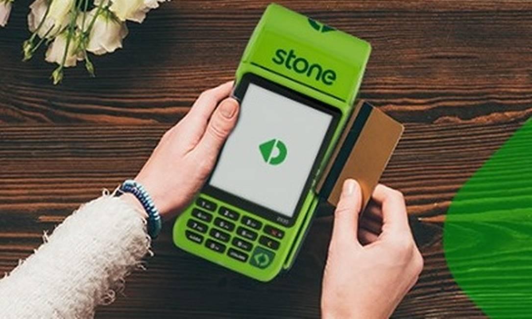 Máquina de pagamentos da Stone: parceria com Grupo Globo. Foto: Reprodução/Facebook Stone