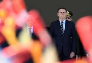 Presidente Jair Bolsonaro observa troca de guarda no Planalto Foto: EVARISTO SA 31-07-2019 / AFP