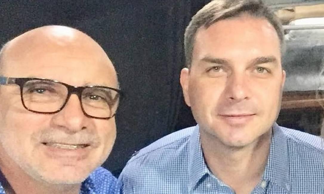 O ex-assessor Fabrício Queiroz e o senador Flávio Bolsonaro Foto: Reprodução