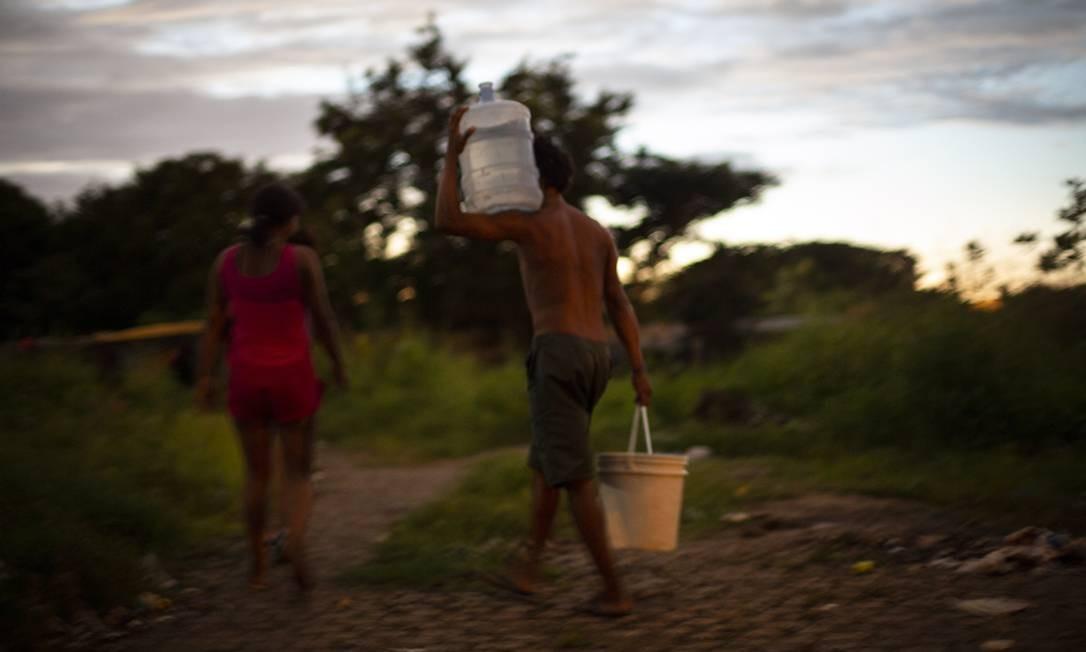 A maioria dos imigrantes entra no pela fronteira norte do Brasil, no estado de Roraima, e se concentra nos municípios de Pacaraima e Boa Vista, capital do estado. Abrigos são administradas pelas Forças Armadas e pela Agência da ONU para Refugiados (ACNUR) Foto: Daniel Marenco / Agência O Globo