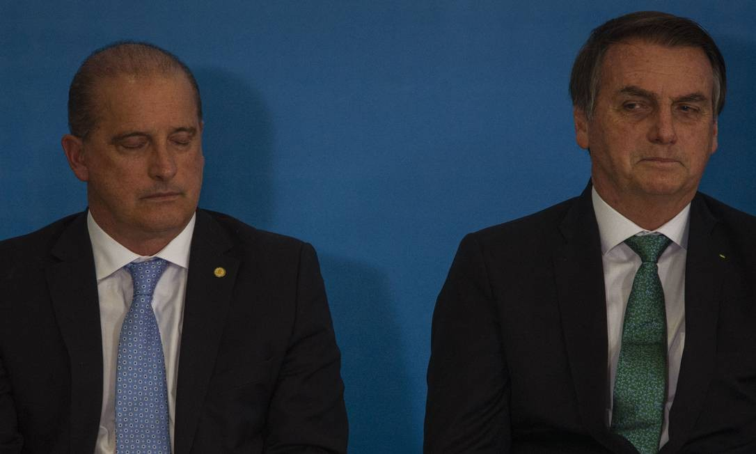 O ministro da Casa Civil, Onyx Lorenzoni e o presidente Jair Bolsonaro, em julho Foto: Daniel Marenco / Agência O Globo