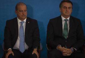 O ministro da Casa Civil, Onyx Lorenzoni, e o presidente Jair Bolsonaro, em julho Foto: Daniel Marenco / Agência O Globo