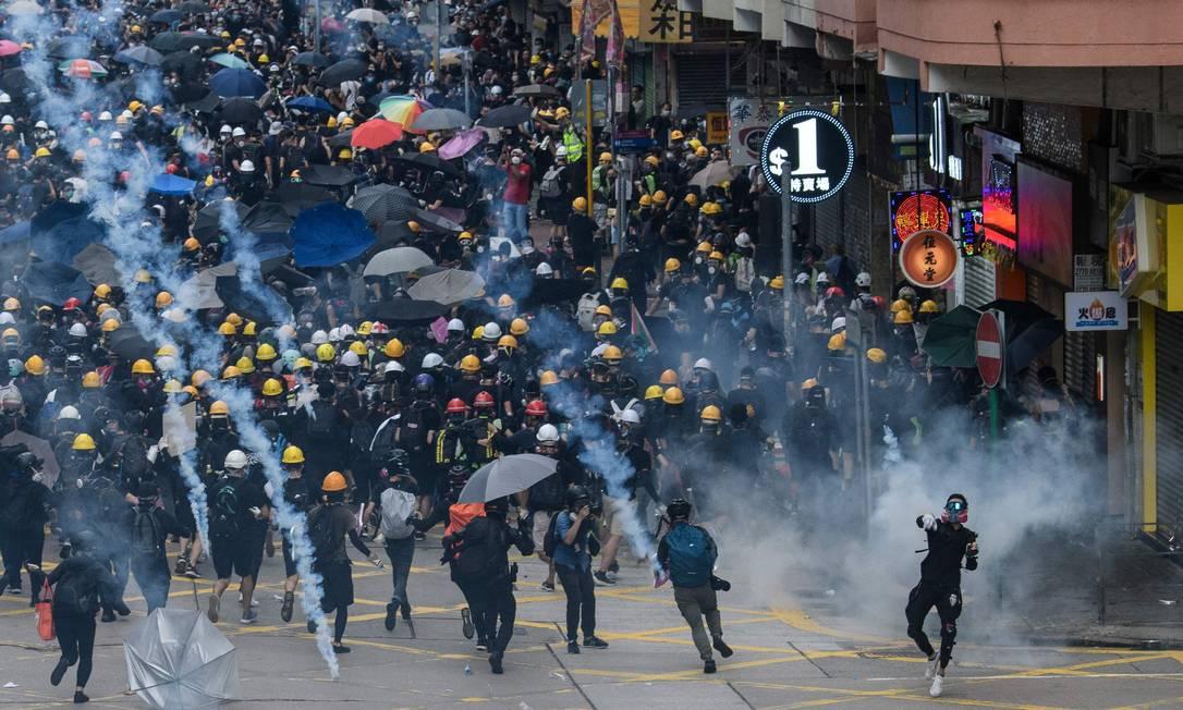 Protestos em Sham Shui Po, em Hong Kong Foto: ANTHONY WALLACE / AFP