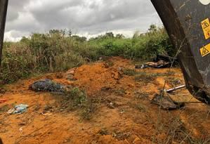 Cemitério clandestino usado por milícia é localizado em Belford Roxo Foto: Reprodução