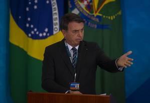 Bolsonaro durante evento na Caixa Econômica Federal, na terça-feira Foto: Daniel Marenco / Agência O Globo