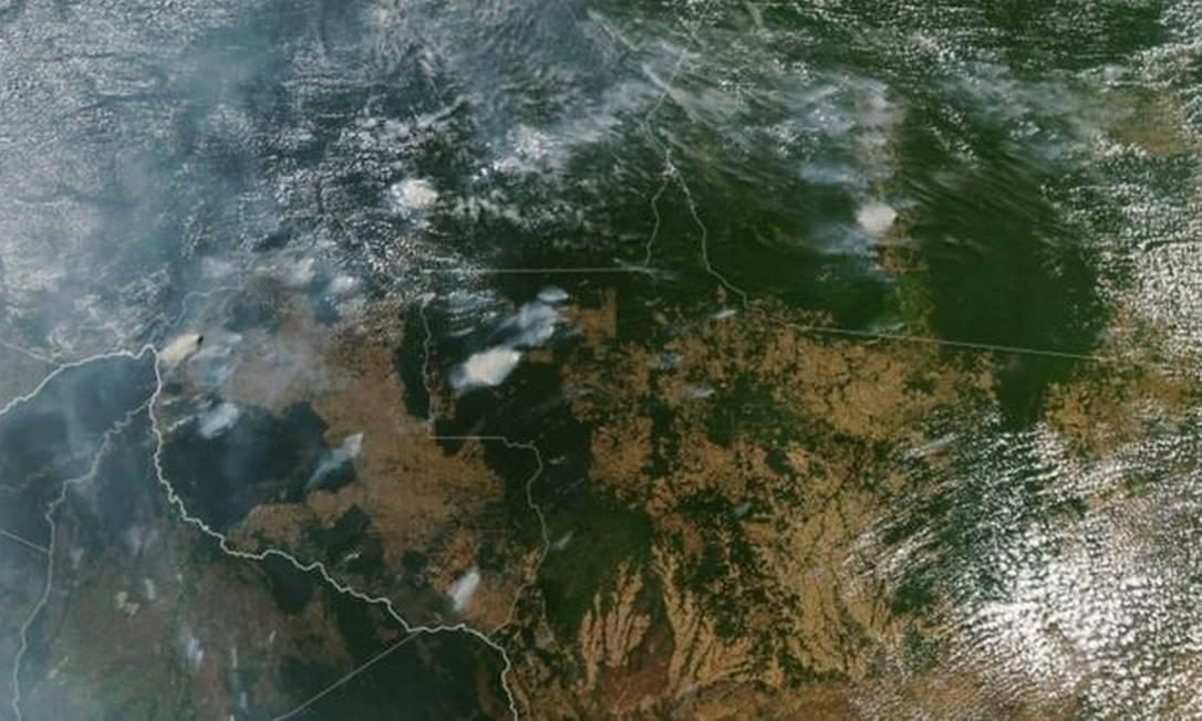 Imagem de satélite da Nasa em 11 de agosto mostram focos de incêndio em Estados brasileiros do Norte e Centro-Oeste Foto: AFP
