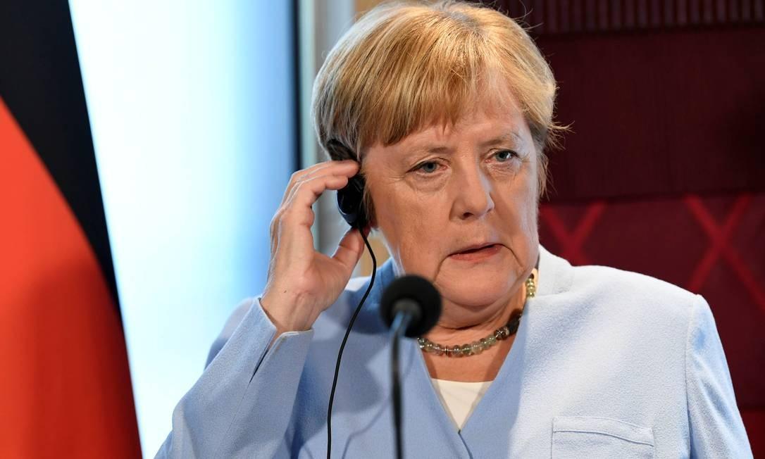 A chanceler federal alemã Angela Merkel 'apoia completamente o presidente francês' neste ponto, declarou porta-voz Foto: PIROSCHKA VAN DE WOUW / REUTERS