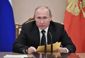 O presidente da Rússia, Vladimir Putin, na reunião do Conselho de Segurança do país nesta sexta: segundo ele, EUA querem instalar mísseis antes proibidos em regiões de todo o mundo Foto: Sputnik/Alexey Nikolsky/Kremlin/Via REUTERS