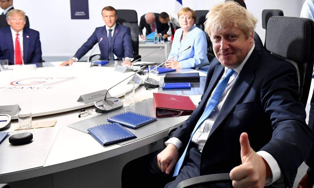 O primeiro-ministro britânico Boris Johnson (direita), a chanceler alemã Angela Merkel, o presidente francês Emmanuel Macron e o presidente dos Estados Donald Trump, participam de uma sessão de trabalho sobre Clima, Biodiversidade e Oceanos durante a Cúpula do G7 em Biarritz, França Foto: POOL / REUTERS