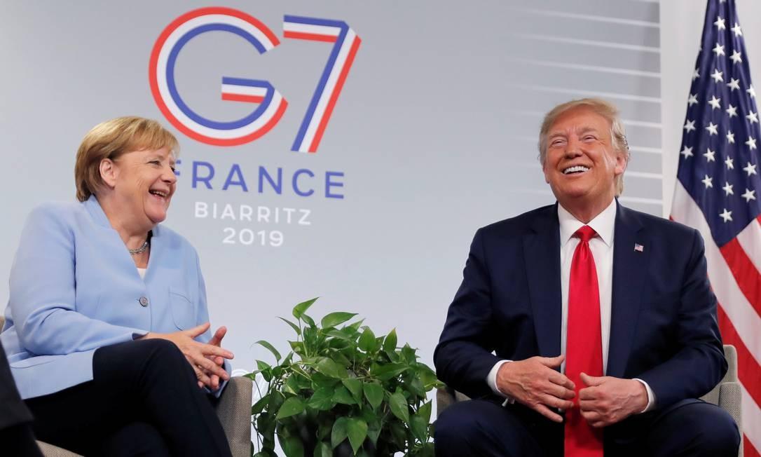 A chanceler da Alemanha Angela Merkel e o presidente dos Estados Unidos Donald, encontro durante a reunião do G7 Foto: CARLOS BARRIA / REUTERS