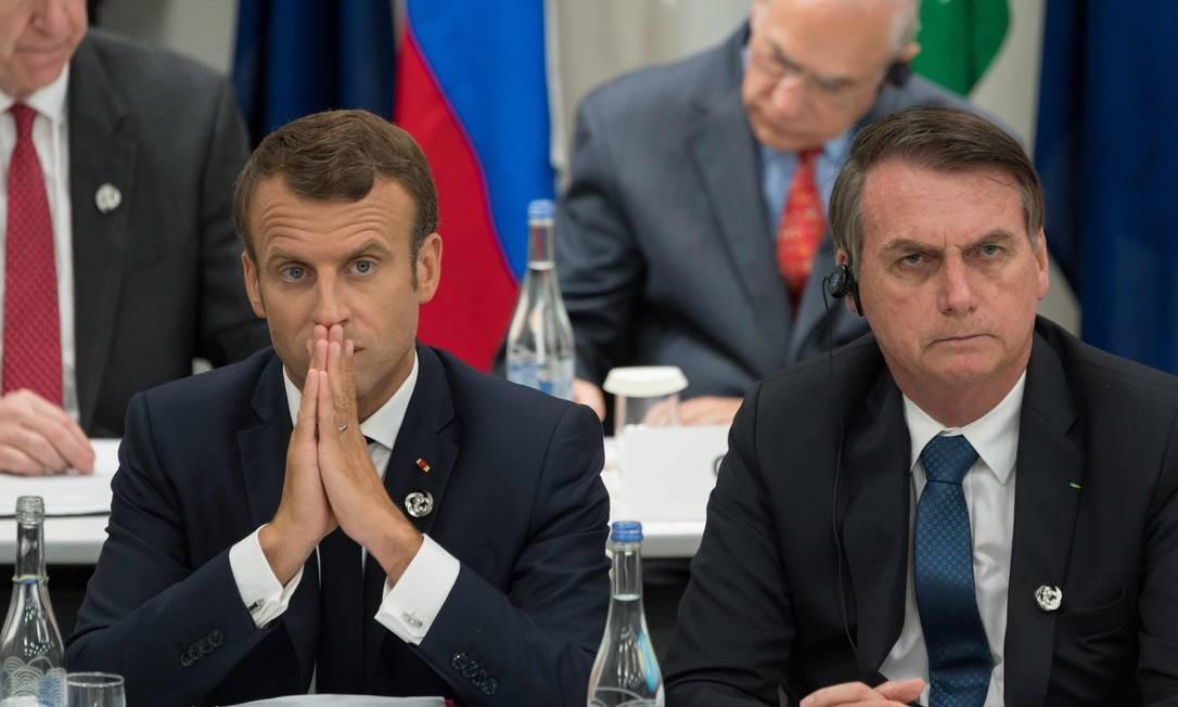 Emmanuel Macron e Jair Bolsonaro durante encontro do G20, em Osaka, no Japão Foto: JACQUES WITT / AFP / 28-06-2019
