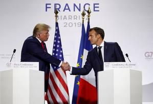 Presidentes dos EUA, Donald Trump, e da França, Emmanuel Macron, durante entrevista no último dia de reunião do G7 Foto: CHRISTIAN HARTMANN / REUTERS