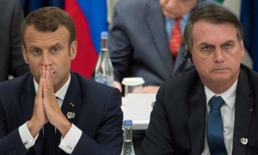 Macron disse que Bolsonaro mentiu ao dizer que atuaria contra o desmatamento, em encontro do G20 em junho, onde sentaram lado a lado Foto: AFP