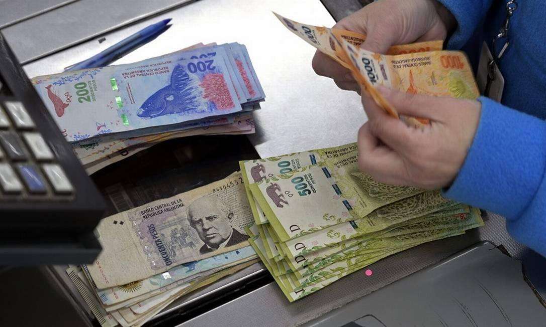 Pesos argentinos: reclassificação. Foto: Juan Mabromata / AFP