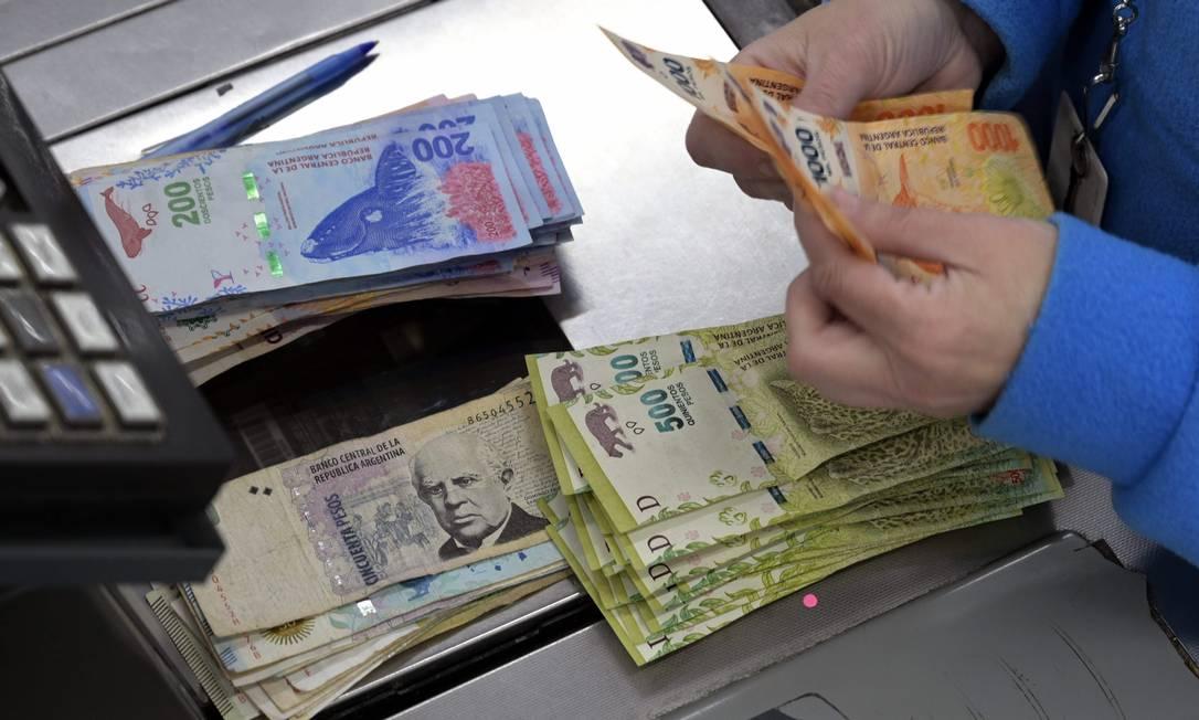 Decisão ocorre dias depois de ao país pedir para estender prazo de vencimento de dívidas Foto: JUAN MABROMATA / AFP