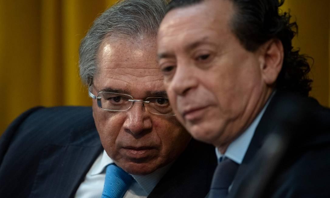 Guedes e Sica: acordo automotivo. Foto: MAURO PIMENTEL / AFP