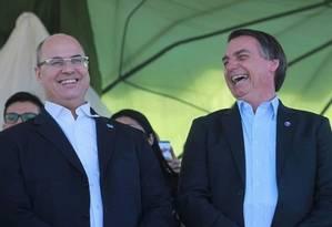 Witzel e Bolsonaro: União ainda não informou se aceitará divisão meio a meio Foto: Divulgação