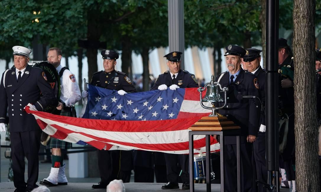 Militares participam da cerimônia de homenagem às vítimas no Memorial do 11 de Setembro. Foto: DON EMMERT / AFP