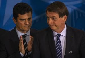Sergio Moro, ministro da Justiça, ao lado do Presidente Bolsonaro Foto: Daniel Marenco / Agência O Globo