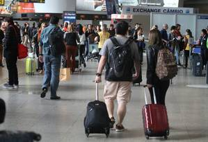 Movimentação no RioGaleão, o aeroporto internacional do Rio Foto: Fabiano Rocha / Agência O Globo
