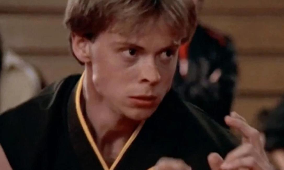 """Garrison como Tommy em """"Karatê Kid: A Hora da Verdade (1984)"""" Foto: Repeodução/Internet"""