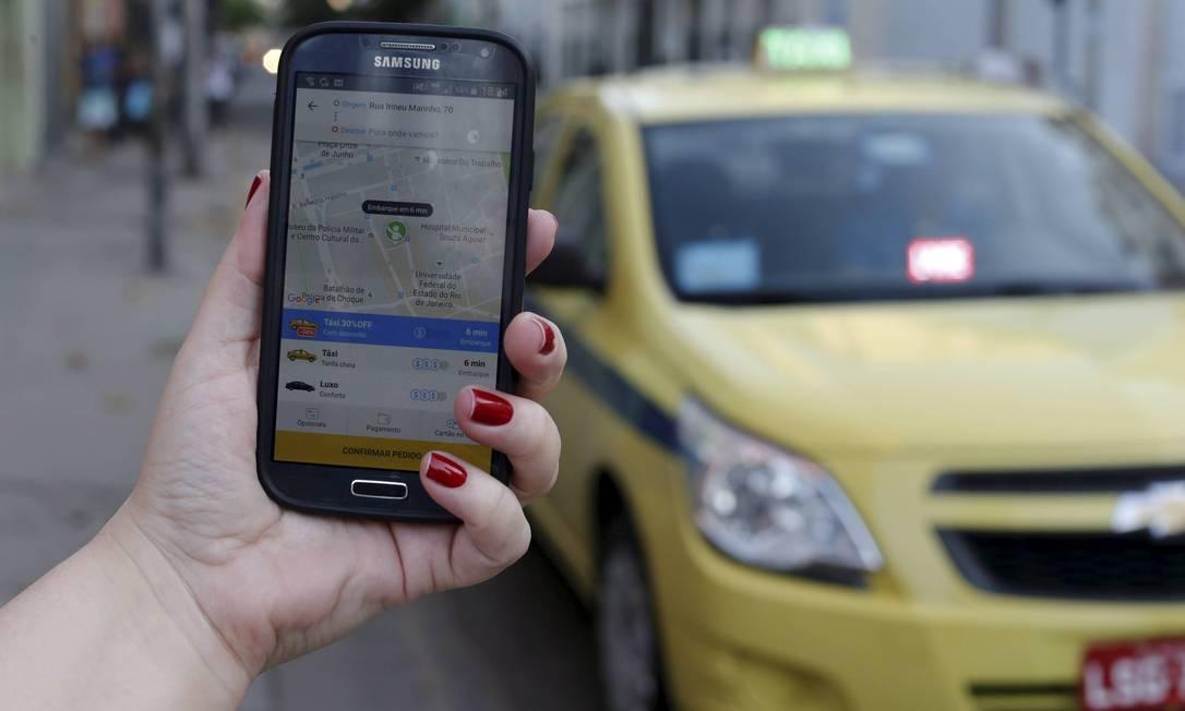 A Didi Chuxing, chamada de Uber chinês, adquiriu a 99, plataforma brasileira de transporte por aplicativo Foto: Domingos Peixoto / Domingos Peixoto/26-10-2016