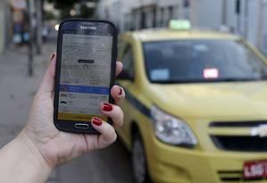 A Didi Chuxing, chamada de Uber chinês, adquiriu a 99, plataforma brasileira de transporte por aplicativo Foto: Domingos Peixoto / Agência O Globo