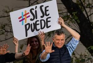 Presidente argentino Mauricio Macri, ao lado de sua mulher Juliana Awada, durante evento de campanha em Buenos Aires Foto: RONALDO SCHEMIDT / AFP / 28-08-2019