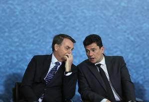 O presidente Jair Bolsonaro e o ministro da Justiça, Sergio Moro, participam da solenidade de lançamento da campanha do projeto anticrime. Foto: Jorge William / O Globo