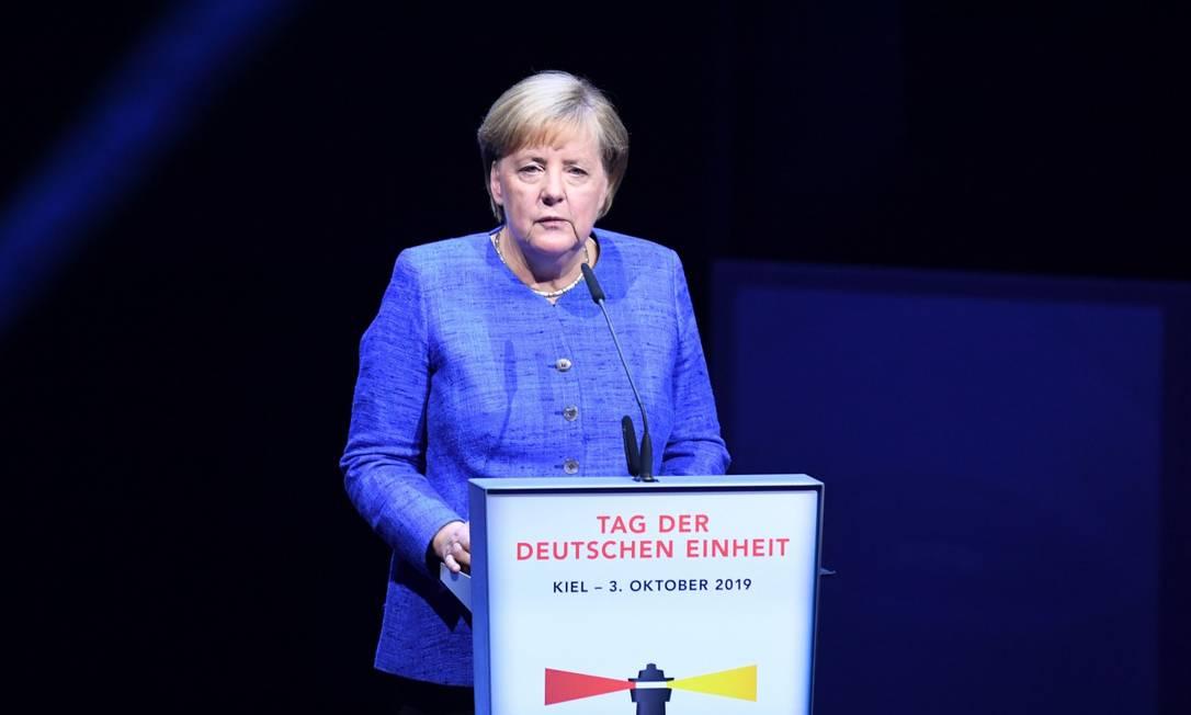 Chanceler federal Angela Merkel durante cerimônia comemorativa da reunificação da Alemanha Foto: CARSTEN REHDER / AFP