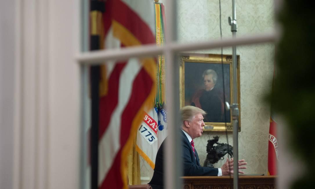 Donald Trump no Salão Oval da Casa Branca Foto: SAUL LOEB / AFP