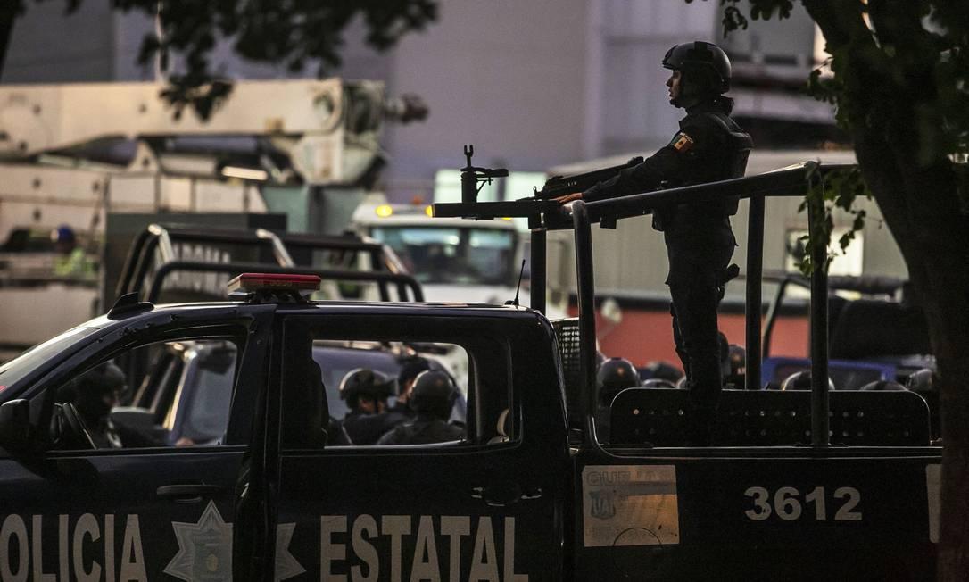 Policiais patrulham as ruas de Culiacán Foto: RASHIDE FRIAS / AFP