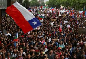 Manifestantes tomaram as ruas de Santiago em 25 de outubro Foto: IVAN ALVARADO / REUTERS