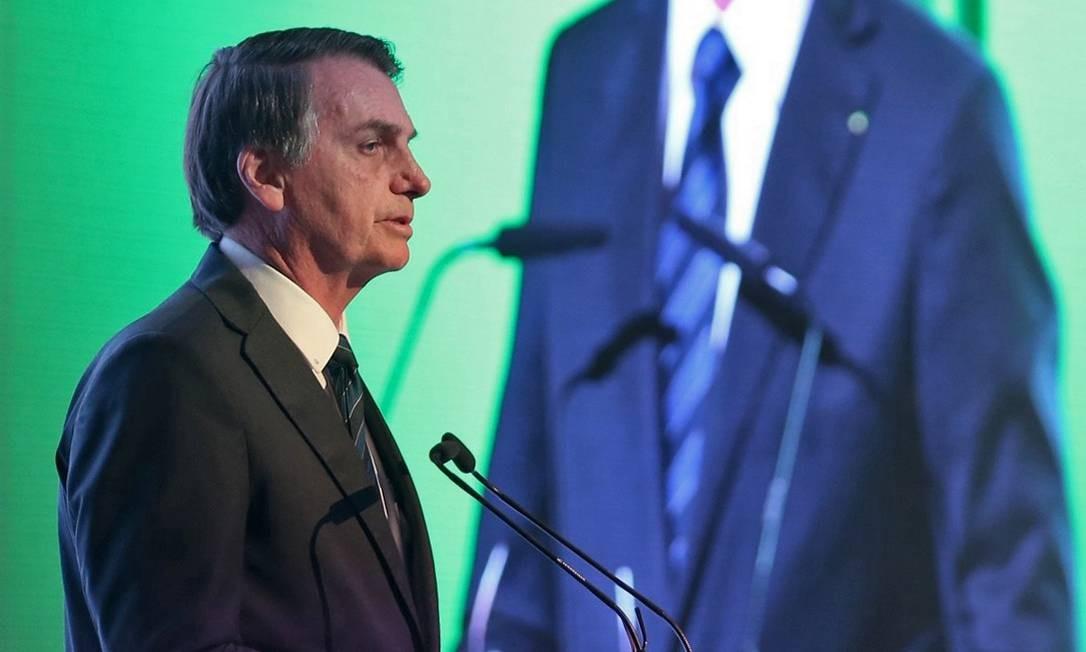 Presidente Jair Bolsonaro fala durante o Fórum de Negócios Brasil-Emirados Árabes, na capital dos Emirados, Abu Dhabi. Foto: - / AFP