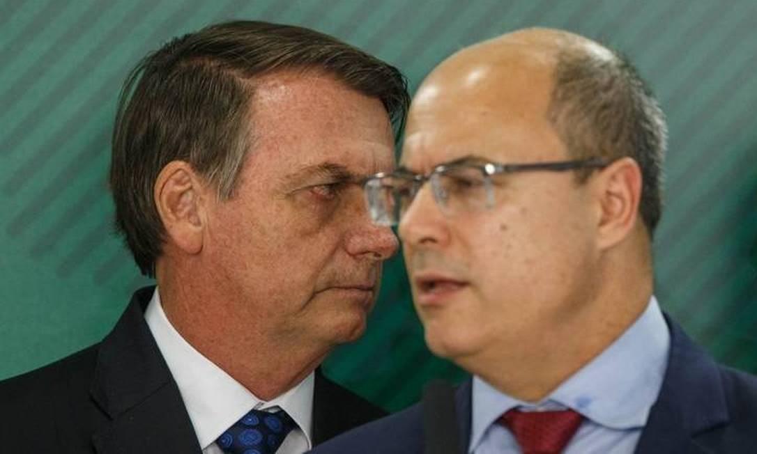O presidente Jair Bolsonaro ao lado do filho o senador Flavio Bolsonaro e o governador do Rio, Wilson Witzel 24-06-2019 Foto: Foto: Daniel Marenco / Agência O Globo