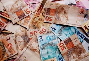 Notas de real: segundo medida, outras empresas poderão fabricar papel-moeda para o país. Foto: Arquivo