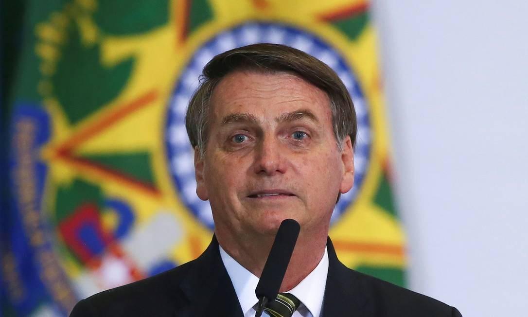 Presidente Jair Bolsonaro durante cerimônia de 300 dias no governo, no Palácio do Planalto Foto: SERGIO LIMA / AFP