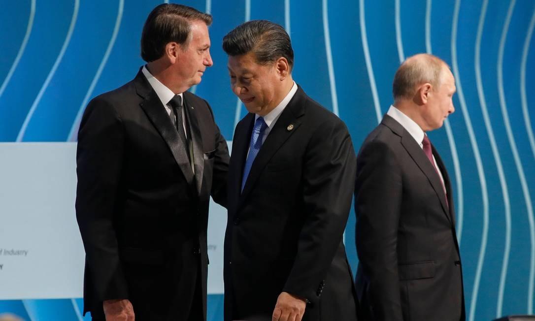 O presidente do Brasil, Jair Bolsonaro, o presidente da Rússia, Vladimir Putin, e o presidente da China, Xi Jinping, participam da 11ª edição da Cúpula do BRICS, em Brasília Foto: SERGIO LIMA / AFP