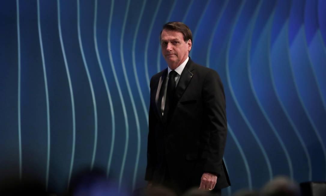 Jair Bolsonaro chega ao palco durante a cúpula do Brics Foto: UESLEI MARCELINO / REUTERS