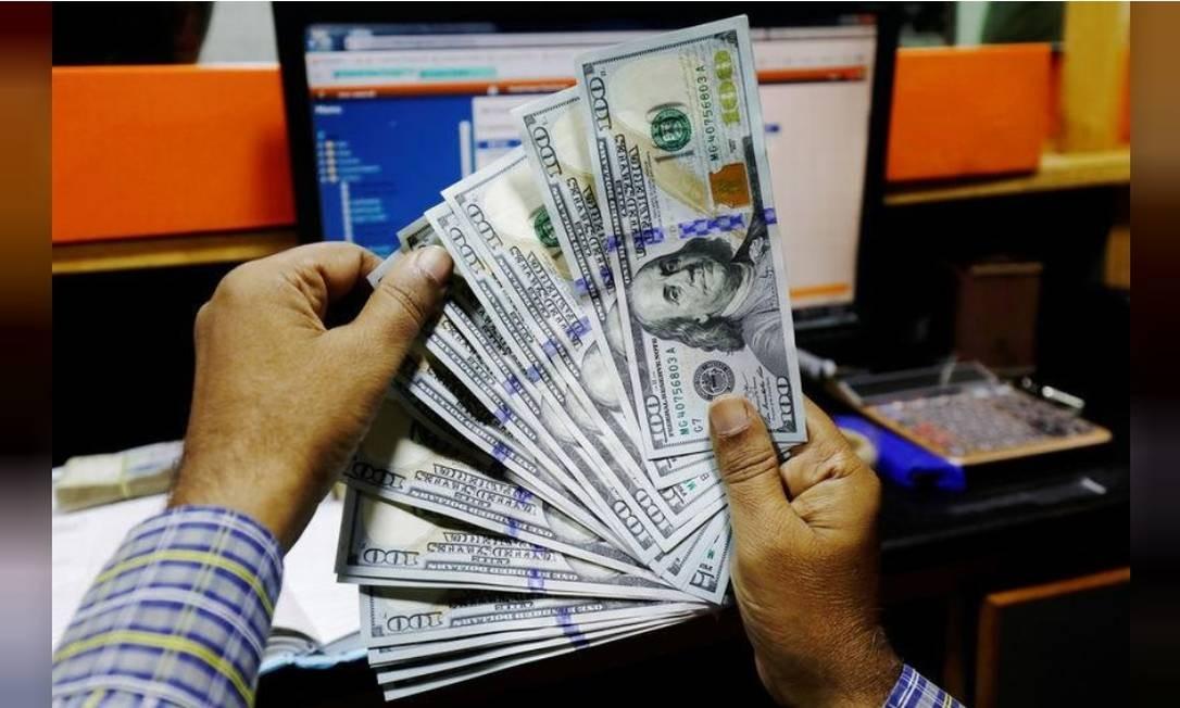 Dólar é negociado em baixa Foto: Reuters