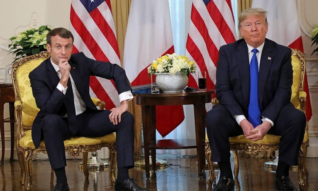 Farpas: Macron e Trump. Foto: LUDOVIC MARIN / AFP
